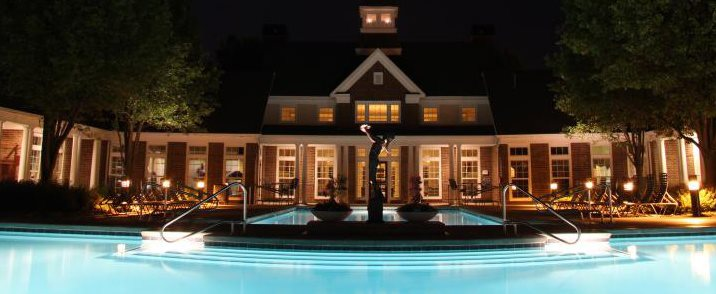 Resort-style pool lighted at night