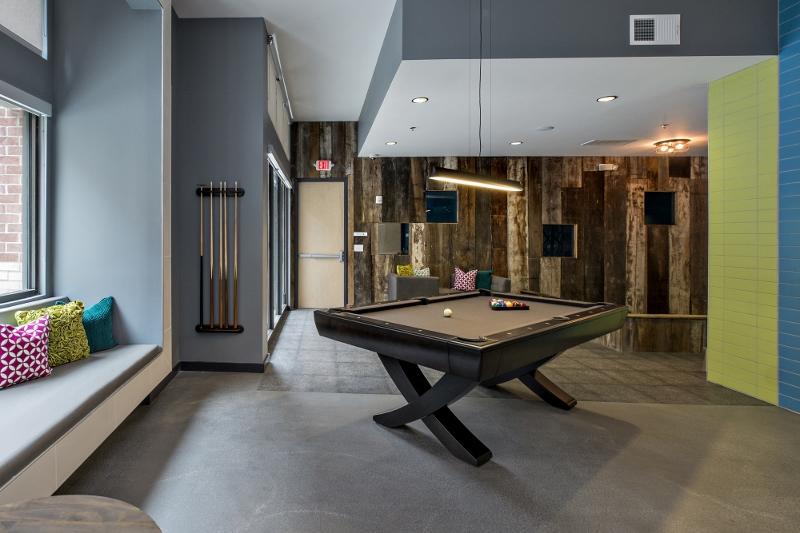 Wood-paneled billiards room