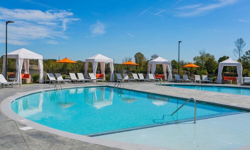 Resort-style pool seating with shade umbrellas