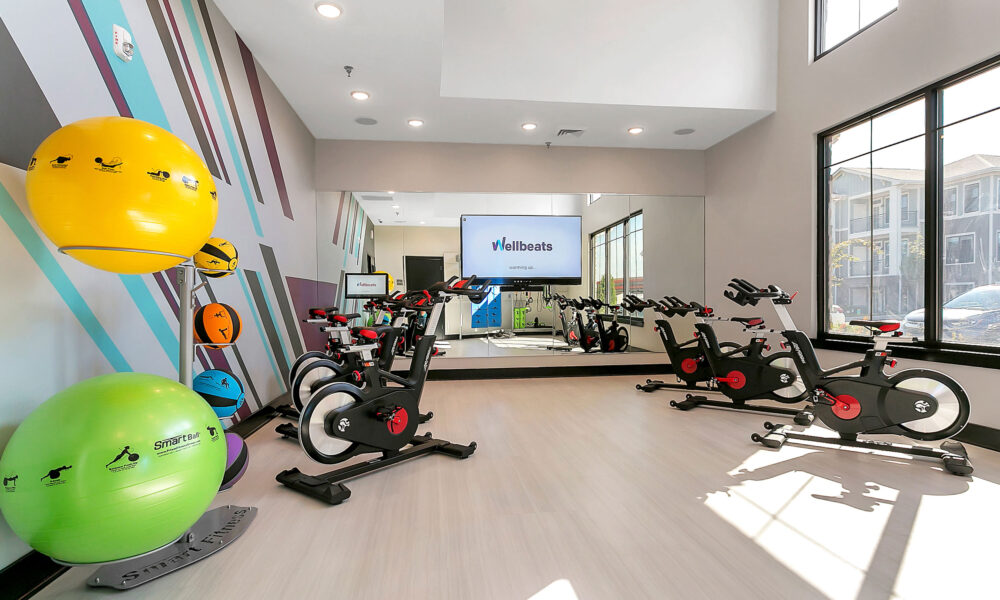 Modern workout center with stationary bikes and fitness equipment