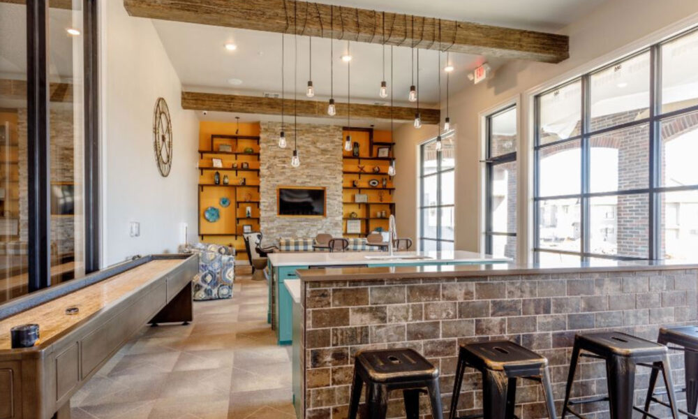 Modern clubhouse kitchen area with tiled bar, buffet table and flatscreen TV