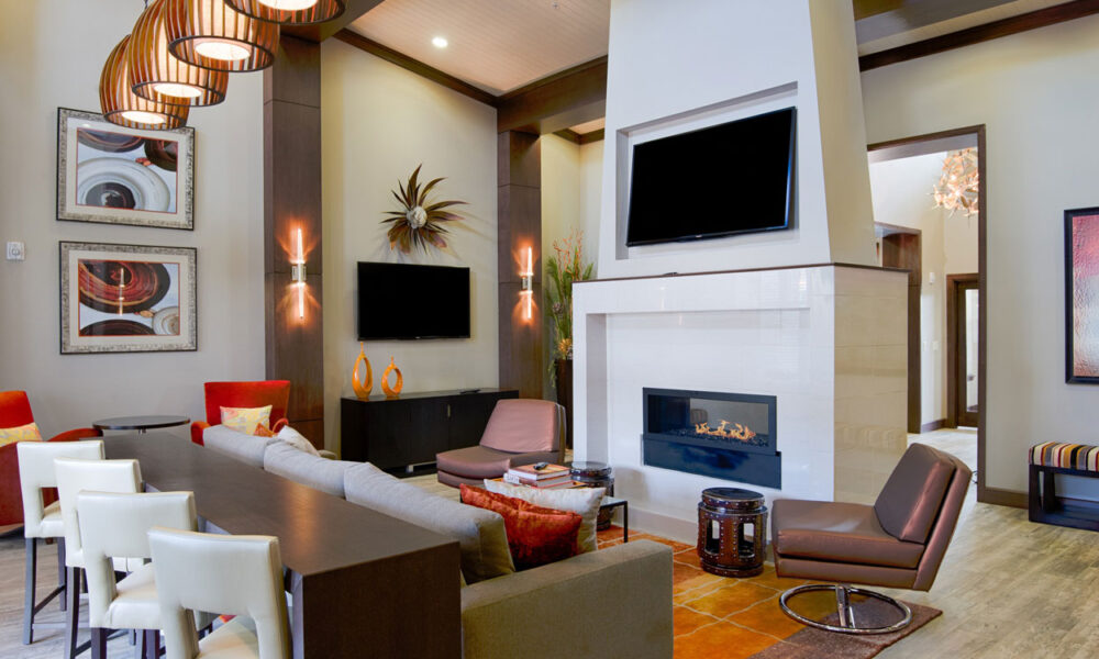 Clubhouse lounge with fireplace and flatscreen TV